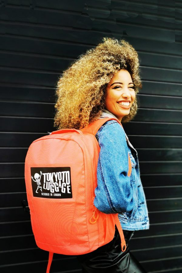 Model with Backpack Coral